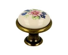 Stylizowana gałka metalowa z wierzchołkiem porcelanowym, zastosowanie kuchenne  Pokrycie galwaniczne - antyczny mosiądz Kolor porcelany - MLK-1 ...