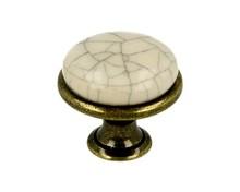 Stylizowana gałka metalowa z wierzchołkiem porcelanowym, doskonała do kuchni lub łazienki.  Pokrycie galwaniczne - mosiądz patyna. Kolor porcelany -...