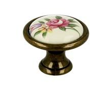 Gałka renomowanej firmy SIRO z kolekcji Romana. Wykonana z metalu w kolorze stary mosiądz oraz wielobarwny motyw kwiatowy.