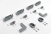 Dodatkowe okucie montażowe Do niewidocznego mocowania profilu w szafach sięgających sufitu Podane zestawy zawierają różne ilości elementów. Zestaw 9...