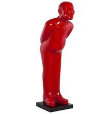 Figurka tego mężczyzny z błogim uśmiechem została wykonana z żywicy poliestrowej, barwionej na lakierowany czerwony. Nowoczesny, dekoracyjny element w...