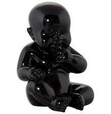 Urocza figurka z ultratrwałej żywicy poliestrowej przedstawia siedzące dziecko. Ozdobny element, który spodoba się każdemu.  Dostępne wersje...