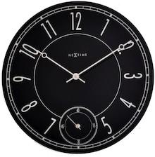 """Zegar 8144 """"Leitbring"""", którego projektantem jest NeXtime, posiada mechanizm skokowy zasilany za pomocą baterii typu AA. Zegar wykonany z szkła w..."""
