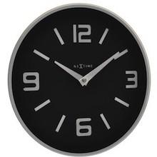 """Zegar 8148 ZW """"Shuwan"""", którego projektantem jest NeXtime, posiada mechanizm skokowy zasilany za pomocą baterii typu AA. Zegar wykonany z szkła w..."""