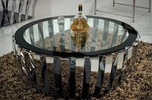 Stolik wykonany jest ze stali nierdzewnej. Blat jest z hartowanego szkła.  Wymiary:  szerokość (cm) 100 głębokość (cm) 100 wysokość (cm) 41