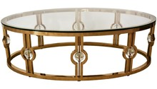 Stolik wykonany jest ze stali nierdzewnej w kolorze złotym. Blat jest z hartowanego szkła.  Wymiary:  szerokość (cm) 130 głębokość (cm) 70...