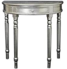 Przyścienna, półokrągła, konsola w kolorze srebrnym, wykonana z drewna, pokryta srebrnym (szlagmetalem).  Szlagmetal to cieniutkie listki metalu...