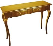 Stylowa komódka w kolorze złotym, wykonana z wysokiej jakości drewna, pokryta złotym (szlagmetalem).  Szlagmetal to cieniutkie listki metalu ręcznie...