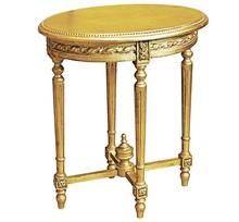 Stylowy owalny rzeźbiony stolik w kolorze country gold, wykonany z wysokiej jakości drewna, pokryty złotym przecieranym (szlagmetalem).  Szlagmetal to...