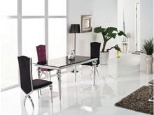 Nowoczesny stół Glamour.  Materiał wykonania: -stal nierdzewna polerowana -czarne hartowane szkło  Wymiary: 150/90/75 cm