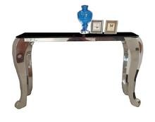 Materiał wykonania: - stal nierdzewna polerowana - hartowane szkło Wymiary:  - szerokość: 130 cm - głębokość: 42 cm - wysokość: 75 cm Dostępne...