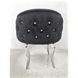 Eleganckie krzesło w obiciu ze skóry ekologicznej, w którym każdy poczuje się wyjątkowo. Oryginalności dodają mu kryształki i stylizowane ze stali...