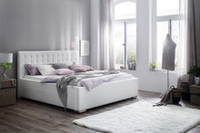Łóżko QUEBEC z pojemnikiem na pościel w bardzo oryginalnej stylistyce.  Dostępne wersje kolorystyczne:  - biały - czarny  Dostępne rozmiary: -...