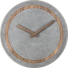 """Zegar 3211 """"Concreto"""" zaprojektowany przez Jette Scheib, wyposażony jest w mechanizm płynący zasilany za pomocą baterii typu AA. Zegar wykonany..."""