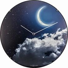 Zegar 3177 New Moon Dome zaprojektowany przez NeXtime, wyposażony jest w mechanizm płynący zasilany za pomocą baterii typu AA. Zegar wykonany ze szkła w...