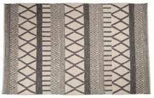 Ręcznie tkany dywan Walker produkcji White Label Livingto doskonale połączenie geometrycznych wzorów ze stonowanym kolorem.  Wykonany jest ze 100...