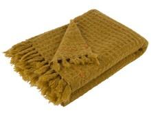 Pled MIMOSA żółty to tkany koc z frędzlami i pomarańczowymi szwami  Wymiary: 170x130 cm  Materiał: 60% akryl, 20% wełna, 20% nylon