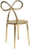 Krzesło Ribbon metalowe złote  Krzesła Ribbon zostały zaprojektowane przez Nika Zupanc, która dołączyła do grona wybitnych projektantów kierowanych...