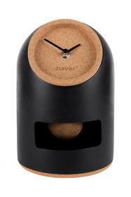 Czarno - brązowy zegar UNO marki Zuiver  Wymiary: 17 x 24,5 cm Model dostępny jest również w biało-brązowej wersji kolorystycznej.