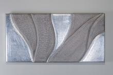 Materiał: drewno,aluminium<br />Kolor: szary, srebrny<br />Panel ścienny SAILOR , zachwyca formą i jakością wykonania. W całości...
